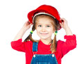 Little girl in the construction helmet Stock Image