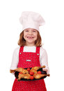 Little girl cook with chicken drumstick Stock Image