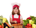 Little girl cook cutting carrot happy Royalty Free Stock Images