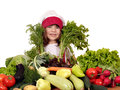 Little girl cook with different vegetables beautiful Royalty Free Stock Image