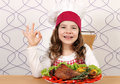 Little girl cook with drumstick and ok hand sign turkey Royalty Free Stock Photo