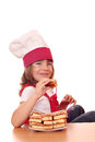 Little girl cook eat apple cake happy Royalty Free Stock Images