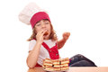 Little girl cook eat apple cake hungry Stock Photography