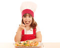 Little girl cook eat salmon seafood hungry Stock Photos