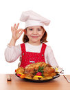 Little girl cook with grilled chicken Stock Images