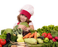 Little girl cook hold cabbage beautiful Stock Photography