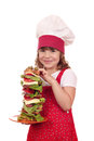 Little girl cook hold tall sandwich happy Royalty Free Stock Images