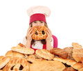 Little girl cook with pretzel Royalty Free Stock Photo