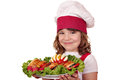 Little girl cook with roasted chicken meat and salad beautiful Royalty Free Stock Image