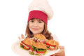 Little girl cook with sandwiches Stock Photography