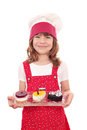 Little girl cook with sweet cakes happy Stock Images