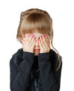 Little girl covers her face with hands Royalty Free Stock Photo