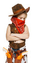 Little girl cowboy standing with folded hands Royalty Free Stock Image