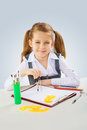 A little girl with crawing compass Royalty Free Stock Photo