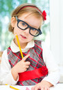 Little girl with crayon cute is playing Stock Image