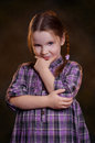 Little girl  with crossed hands on the chest. Stock Images