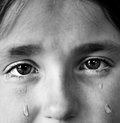 Little girl crying with tears portrait of rolling down her cheeks Royalty Free Stock Photos