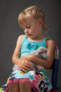 Little girl cuddling her favourite soft toy Royalty Free Stock Photo
