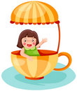Little girl in a cup Stock Images