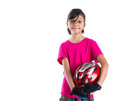 Little girl with cycling attire i asian malay helmet and Royalty Free Stock Photo