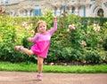 Little girl dancing in the park like ballerina Royalty Free Stock Photo