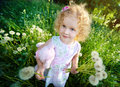 Little girl with dandelions. Stock Photos