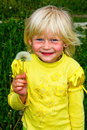 Little girl with dandelions Royalty Free Stock Images