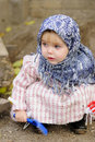 The little girl in a dark blue kerchief Royalty Free Stock Photos