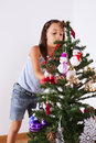 Little girl decorating a christmas tree happy Royalty Free Stock Photos