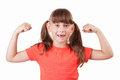 Little girl demonstrates his biceps Royalty Free Stock Photos