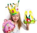 Little girl demonstrating her craft works, Easter bonnets