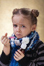 Little girl does not like cough syrup or medicine Royalty Free Stock Photography