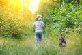 Little girl with dog walking in the forest Stock Photography