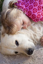 Little girl with dog a young child sleeping her golden retriever guarding her candid shot of real people Stock Photography