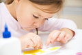 Little girl doing arts and crafts in preschool Royalty Free Stock Image