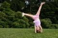 Little girl doing a cartwheel Royalty Free Stock Photo