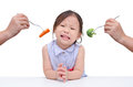 Little girl don t want to eat vegetables crying because Stock Photography