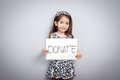 Little girl with donations sign Royalty Free Stock Photo