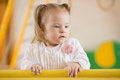 Little girl with down syndrome learns to stand Stock Photo