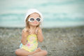 Little girl with down syndrome wore glasses and poses faces Royalty Free Stock Images