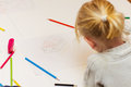 Little girl drawing with colorful crayons Royalty Free Stock Photos