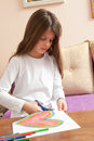 Little Girl is Drawing Colorful Heart