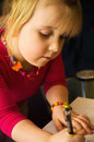 Little girl drawing with pen a cute at home a focused on her children artwork Stock Photo