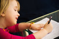 Little girl drawing with pen a cute at home a focused on her children artwork Royalty Free Stock Photos