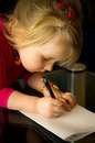 Little girl drawing with pen a cute at home a focused on her children artwork Stock Photography
