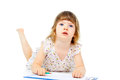 Little girl drawing with a pencil Royalty Free Stock Image