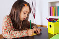 Little girl drawing with a pencil at her home Stock Images