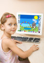 Little girl draws at the computer Royalty Free Stock Image