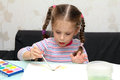 Little girl draws paints Royalty Free Stock Image