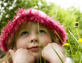 Little girl dreams in the grass Royalty Free Stock Photo